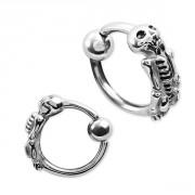 Piercing anneau captif à squelette en relief