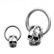 Piercing anneau captif à tête de mort et griffes