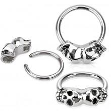 Piercing anneau captif avec fixation à têtes de mort