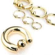 Piercing anneau captif plaqué or